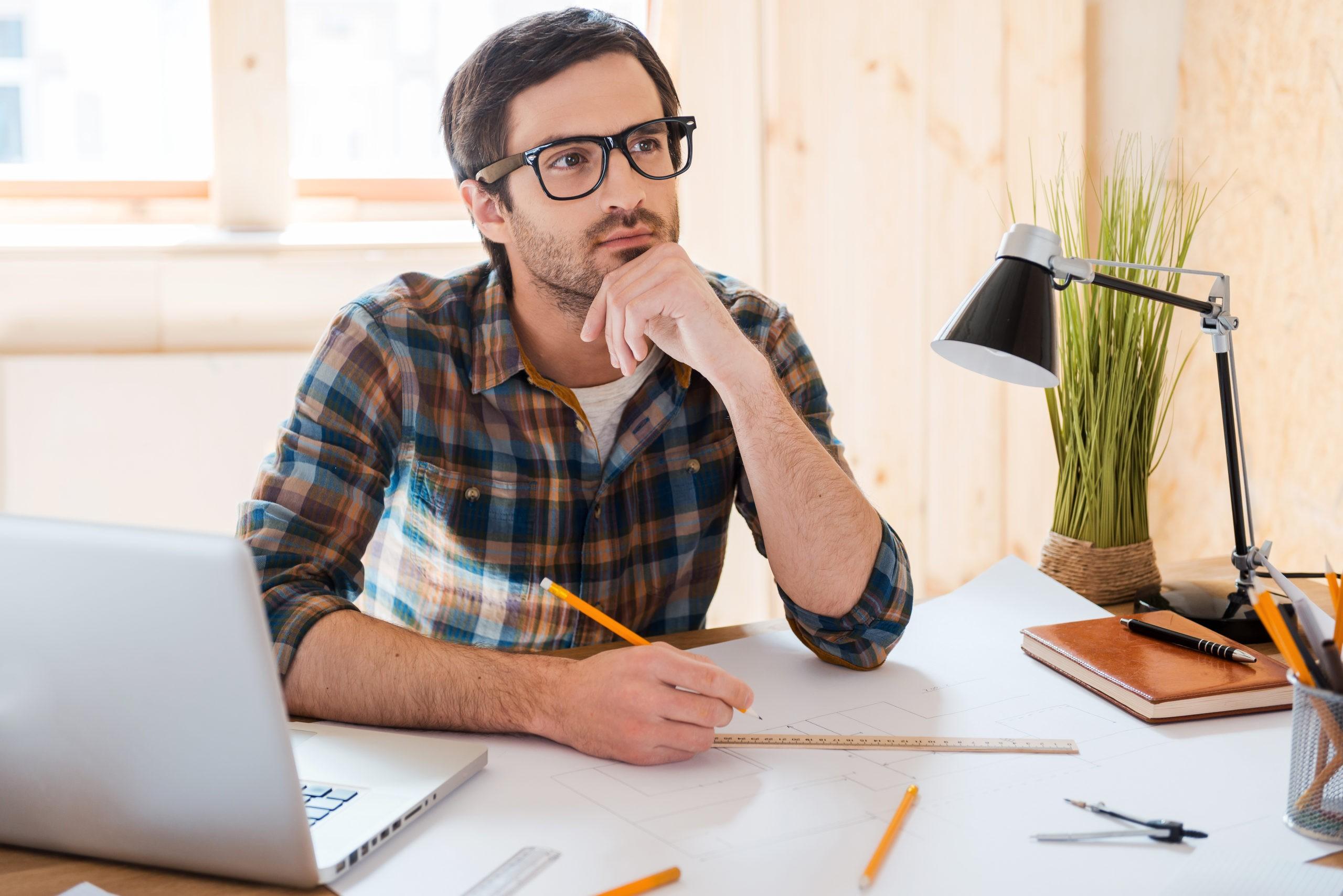 Man Thinking sitting at computer scaled